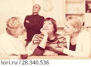 Купить «Mature woman is sitting upset and her girlfriends are expressioning understanding to she», фото № 28340536, снято 16 декабря 2017 г. (c) Яков Филимонов / Фотобанк Лори