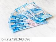 Купить «Купюры в две тысячи рублей на светло-сером фоне», фото № 28343096, снято 21 апреля 2018 г. (c) Дудакова / Фотобанк Лори
