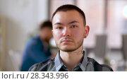 Купить «asian man with tattoo and ear tunnel at office», видеоролик № 28343996, снято 12 апреля 2018 г. (c) Syda Productions / Фотобанк Лори