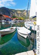 Купить «Montenegro. Embankment in Kotor with boats and yachts on the clear blue water of the  Boka Kotor Bay on a Sunny day», фото № 28346364, снято 8 октября 2016 г. (c) Виктория Катьянова / Фотобанк Лори