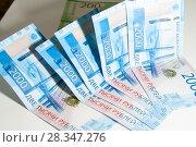 Купить «российские рубли мелкими купюрами», фото № 28347276, снято 29 апреля 2018 г. (c) Момотюк Сергей / Фотобанк Лори