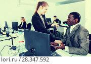 Купить «Sexual harassment between two colleagues and flirting in office», фото № 28347592, снято 24 марта 2018 г. (c) Яков Филимонов / Фотобанк Лори