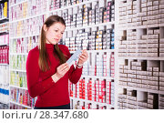 Купить «Female buying hair dye», фото № 28347680, снято 22 марта 2018 г. (c) Яков Филимонов / Фотобанк Лори