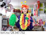 Купить «Girl in store of festival accessories», фото № 28347732, снято 15 марта 2018 г. (c) Яков Филимонов / Фотобанк Лори