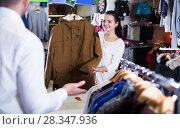 Купить «Couple choosing new coat», фото № 28347936, снято 22 ноября 2016 г. (c) Яков Филимонов / Фотобанк Лори
