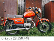 Купить «MINSK, BELARUS - SEPTEMBER 22, 2013: Old Red Russian (Soviet) Motorcycle 'Voshod' Parked On Green Grass Yard. This motorcycles produced at Degtyarev plant in Russian town Kovrov since 1965.», фото № 28350448, снято 22 сентября 2013 г. (c) easy Fotostock / Фотобанк Лори