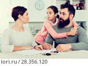 Купить «Father and mother signing divorce papers», фото № 28356120, снято 27 мая 2018 г. (c) Яков Филимонов / Фотобанк Лори