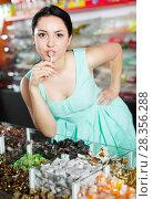 Young woman suck candy at candies shop. Стоковое фото, фотограф Яков Филимонов / Фотобанк Лори