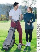Купить «Male and female golfers ready for team play at golf course», фото № 28356580, снято 16 февраля 2019 г. (c) Яков Филимонов / Фотобанк Лори