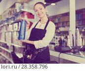Купить «Professional young woman hairstylist holding shampoo in shop», фото № 28358796, снято 31 марта 2018 г. (c) Яков Филимонов / Фотобанк Лори