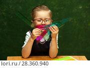 Купить «Positive cute little boy posing at school desk», фото № 28360940, снято 22 сентября 2017 г. (c) Pavel Biryukov / Фотобанк Лори