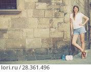 Купить «Romantic girl with stone wall background», фото № 28361496, снято 15 августа 2017 г. (c) Яков Филимонов / Фотобанк Лори