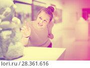 Купить «Young female visitor looking at exhibition in museum of ancient sculpture», фото № 28361616, снято 18 ноября 2017 г. (c) Яков Филимонов / Фотобанк Лори