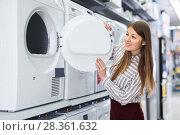 Купить «Modern female housewife choosing new washer», фото № 28361632, снято 12 декабря 2017 г. (c) Яков Филимонов / Фотобанк Лори