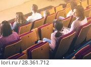 Купить «Smiling audience expecting movie to begin», фото № 28361712, снято 3 декабря 2016 г. (c) Яков Филимонов / Фотобанк Лори