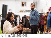 Купить «couple choosing footwear at vintage clothing store», фото № 28363048, снято 30 ноября 2017 г. (c) Syda Productions / Фотобанк Лори