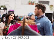 Купить «happy couple at vintage clothing store hanger», фото № 28363052, снято 30 ноября 2017 г. (c) Syda Productions / Фотобанк Лори