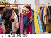 happy couple having fun at vintage clothing store. Стоковое фото, фотограф Syda Productions / Фотобанк Лори