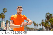 Купить «man with fitness tracker training outdoors», фото № 28363084, снято 5 июля 2015 г. (c) Syda Productions / Фотобанк Лори
