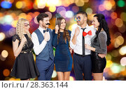 Купить «happy friends with party props over festive lights», фото № 28363144, снято 3 марта 2018 г. (c) Syda Productions / Фотобанк Лори