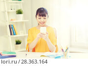 Купить «happy young woman student with smartphone at home», фото № 28363164, снято 9 марта 2016 г. (c) Syda Productions / Фотобанк Лори