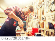 Купить «carpenter with drill drilling plank at workshop», фото № 28363184, снято 14 мая 2016 г. (c) Syda Productions / Фотобанк Лори