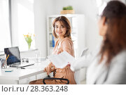 Купить «businesswomen giving each other papers at office», фото № 28363248, снято 17 марта 2018 г. (c) Syda Productions / Фотобанк Лори