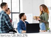 Купить «happy creative team with coffee working at office», фото № 28363276, снято 1 апреля 2018 г. (c) Syda Productions / Фотобанк Лори