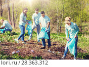 Купить «volunteers with garbage bags cleaning park area», фото № 28363312, снято 7 мая 2016 г. (c) Syda Productions / Фотобанк Лори