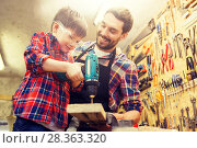 Купить «father and son with drill working at workshop», фото № 28363320, снято 14 мая 2016 г. (c) Syda Productions / Фотобанк Лори