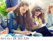 group of students with notebooks at school yard. Стоковое фото, фотограф Syda Productions / Фотобанк Лори