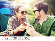 Купить «happy couple clinking drinks at campsite tent», фото № 28363352, снято 27 мая 2016 г. (c) Syda Productions / Фотобанк Лори