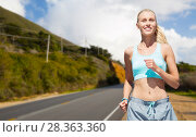 Купить «happy woman running nearby road over big sur hills», фото № 28363360, снято 5 июля 2015 г. (c) Syda Productions / Фотобанк Лори