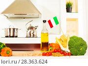 Купить «Italian food with copy space on the kitchen table», фото № 28363624, снято 16 апреля 2016 г. (c) Сергей Новиков / Фотобанк Лори