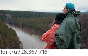 Купить «Young caucasian couple standing at the hillside over the mountain river enjoing beautiful nature», видеоролик № 28367716, снято 18 июня 2019 г. (c) Константин Шишкин / Фотобанк Лори