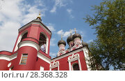 Купить «Temple of Tikhvin Icon of Mother of God in Moscow, Russia», видеоролик № 28368328, снято 1 мая 2018 г. (c) Володина Ольга / Фотобанк Лори