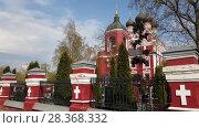 Купить «Temple of Tikhvin Icon of Mother God in Moscow, Russia», видеоролик № 28368332, снято 30 апреля 2018 г. (c) Володина Ольга / Фотобанк Лори
