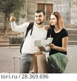 Купить «Enthusiastic man and woman traveling with map and baggage», фото № 28369696, снято 25 мая 2017 г. (c) Яков Филимонов / Фотобанк Лори