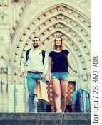 Купить «Couple going the historic city center», фото № 28369708, снято 25 мая 2017 г. (c) Яков Филимонов / Фотобанк Лори