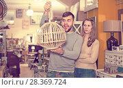 Купить «Raptured guy and surprised girl wth hanging lamp», фото № 28369724, снято 9 ноября 2017 г. (c) Яков Филимонов / Фотобанк Лори