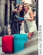 Купить «Two women with baggage checking route outdoors», фото № 28370016, снято 21 июня 2018 г. (c) Яков Филимонов / Фотобанк Лори