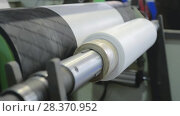 Купить «Receiving drum and feeding rollers of extruder machine», видеоролик № 28370952, снято 12 апреля 2018 г. (c) Андрей Радченко / Фотобанк Лори