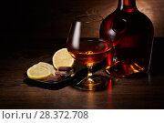 Купить «Cognac, lemon and chocolate.», фото № 28372708, снято 26 апреля 2018 г. (c) Мельников Дмитрий / Фотобанк Лори