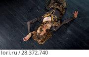 Купить «Attractive woman in bright costume dance lying on the floor with a snake», видеоролик № 28372740, снято 23 июля 2018 г. (c) Константин Шишкин / Фотобанк Лори