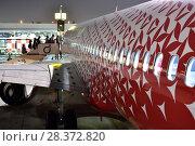 Купить «Dubai, UAE - April 10. 2018. boarding airline Rossiya at the airport», фото № 28372820, снято 10 апреля 2018 г. (c) Володина Ольга / Фотобанк Лори