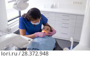 Купить «dentist checking for kid teeth at dental clinic», видеоролик № 28372948, снято 26 апреля 2018 г. (c) Syda Productions / Фотобанк Лори