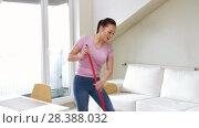 Купить «woman or housewife with mop cleaning floor at home», видеоролик № 28388032, снято 30 апреля 2018 г. (c) Syda Productions / Фотобанк Лори