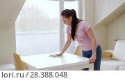 Купить «woman cleaning table with microfiber cloth at home», видеоролик № 28388048, снято 30 апреля 2018 г. (c) Syda Productions / Фотобанк Лори