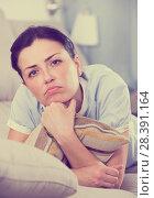 Купить «Portrait of gloomy young woman with pillow», фото № 28391164, снято 2 июня 2017 г. (c) Яков Филимонов / Фотобанк Лори