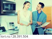 Купить «Family couple looking for stylish modern kitchen fronts», фото № 28391504, снято 15 июня 2017 г. (c) Яков Филимонов / Фотобанк Лори